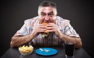 greedy-overweight-man-eating-junk-food